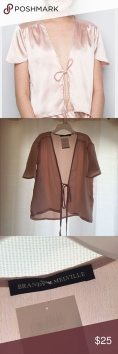 Brandy Melville Pink Silk Tie Top Brand new, still with tags, bought two with different colors and chose to give this one up. Super cute and soft fabric Brandy Melville Tops