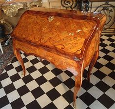 """Very fine, French, Louis XV period bureau dos d'ane.  With floral marquetry resting upon four delicately shaped cabriole legs; having original gilded bronze mounts and fall-front lid that opens to reveal leather writing surface and four interior drawers. Stamped """"Boudin."""" Mid-18th century."""