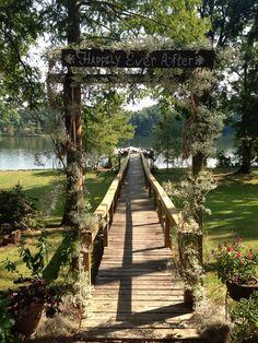 Outdoor wedding ceremony. Wedding arch. Shabby chic country wedding.