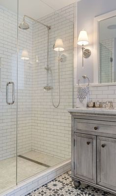 The master bathroom features subway tile, Carrara marble, and Moroccan-style cement tile on the floor.