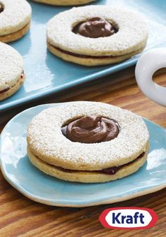 Chocolate-Topped Linzer Cookies – These Linzer cookies are everything you'd expect from a delectable dessert—buttery cookies, raspberry jam, powdered sugar—with a bonus dollop of creamy chocolate!