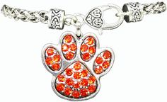 "Great Orange crystal Tiger Paw toggle bracelet in silverplate * 7.5"" Long Spiga Chain * Lobster Claw Closure * 1"" Paw Print Charm * Crystal Accents Great new addition to Clemson fans jewelry collection! $15.00   You can find these at www.yvonnesjewelry.net"
