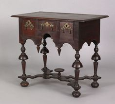 "Pook & Pook.  4/21/07.  Lot 747.  Estimated: $100K - $150K.  Realized: $585K.  PA. William & Mary mahogany dressing table, ca. 1720. Molded edge top overhanging a case with 3 short drawers & arched skirt with applied beaded edge & conical drops supported by bold oblong inverted trumpet turned legs, joined by elaborate serpentine cross stretcher with turned dished china stand, retaining period brass hardware & china stand, 30"" h., 27 1/2"" w."