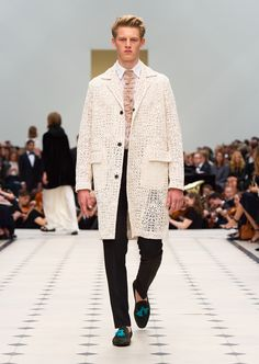 White starched lace caban, black wool mohair straight leg trousers and suede tassel loafers. Discover the collection at Burberry.com