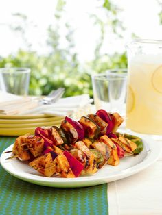Sweet BBQ Chicken Kabobs -- This healthy living BBQ chicken kabob recipe has an island vibe going on. Think OJ, fresh pineapple and peppers. Now all you need is a drink with an umbrella.