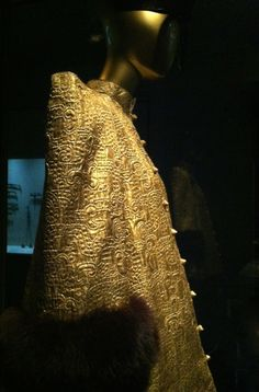 YSL gold brocade trapeze jacket trimmed in mink. China: Through the Looking Glass exhibit at the Met in New York City. Zippertravel.com Digital Edition