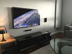 Wall mounted TV with Mac Mini media center.