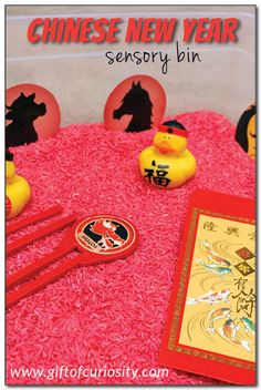 chinese new year sensory bin using dyed rice and chinese themed objects what a