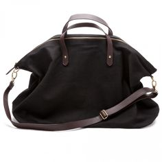 Cuyana's weekend bag: simple, yet oh-so-perfect. Even the choosiest lady can't resist canvas, leather, and black. ($120)    Read more: http://www.dwell.com/slideshows/gift-guide-women.html?slide=3=y=true#ixzz2E6bGJfJb