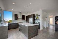 Modern Kitchen with Undermount sink, European Cabinets, Simple granite counters, U-shaped, Ceramic Tile, Kitchen island