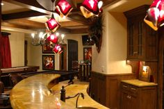 Luxurious Tuscan inspired game room with wet bar.