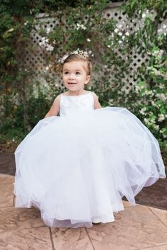 Adorable tulle flower girl gown: http://www.stylemepretty.com/little-black-book-blog/2016/07/27/beaming-bride-major-wedding-goals/ | Photography: Hello Blue Photo - http://hellobluephoto.com/