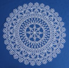 Old, anonymous tatting design: I tatted this doily by reading the pattern off the original doily to form a pair -Judith Connors!