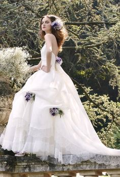 A ball gown will make you feel like a bride, but those with pick-ups lining the skirt will make your feel like a princess