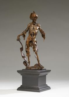 """Attributed to Hans Leinberger (German, active 1511 - 1530) (Sculptor)  Dimensions: H: 9 3/4 in. (24.7 cm)  This is an outstanding example of a """"memento mori,"""" or """"reminder of death"""": a gruesome skeleton clothed in tattered flesh holds a scroll bearing the Latin inscription, """"I am what you will be. I was what you are. For every man is this so.""""  That the artist--probably Hans Leinberger--has depicted the cadaver in a graceful pose that mimics that of Adam in Albrecht Dürer's famous engraving…"""