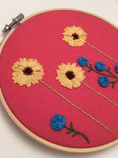 This flower embroidery hoop art is so gorgeous. Sunflower and roses have been hand embroidered using silk ribbon. It would make the perfect gift for a mom, sister, wife or grandma!