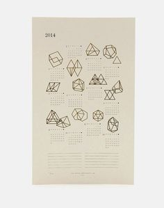 Geometric prisms are accented in gold foil, giving this calendar a glimmer of gleam.