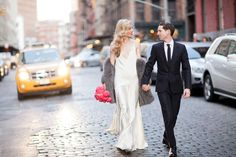 Harper's Bazaar senior market editor Joanna Hillman wearing Rochas and Aram Green wearing Dior Homme in New York City