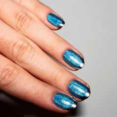 Blue glitter French mani with silver tips