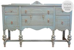 I LOVE this piece. My buffet has a similar shape. I wonder if I could make it look like this.