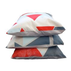 These hand-screen printed geometric cushion covers (onto organic cotton too!) by pombypomegranate are awesomely unique.