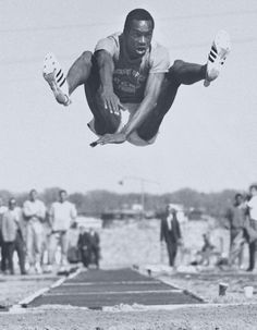 """Bob Beamon October 18, 1968 World long jump was beat by Bob Beamon, record at 29 ft., 2½ in. in at the Mexico City Summer Olympics. His long jump bettered the world record by over 21""""."""