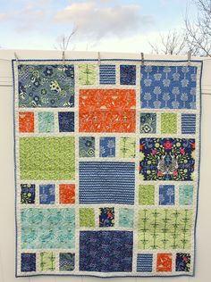 "Downloadable PDF PATTERN The perfect quilt for showing off large prints. Throw-size (77"" x 90"") Fabric Requirements: 13 Fat Quarters 1 7/..."