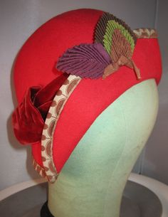 Antique 1930s Flapper Ruby Red Wool Cloche Hat.  via Etsy.