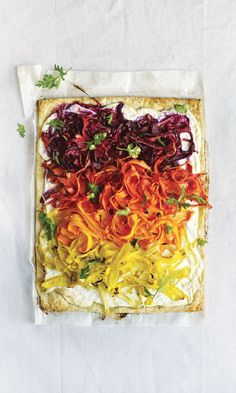 Piles of colorful carrot ribbons—which skew more savory than sweet, thanks to a lemony coriander-flecked dressing—come out of the oven glistening and retaining some of their bite.