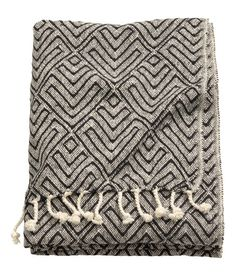 Check this out! Jacquard-weave throw in cotton fabric with fringe on short sides. - Visit hm.com to see more.