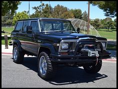 1984 Jeep Grand Wagoneer  Restored by WCC for Arnold Schwarzenegger at Mecum Auctions