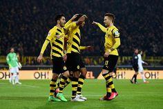 Pierre-Emerick Aubameyang of Borussia Dortmund celebrates with team mates as he scores the third goal during the Bundesliga match between Borussia Dortmund http://www.sportskeeda.com/football/video-aubameyang-scores-brilliant-outside-boot-through-ball-marco-reus