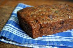 vegan zucchini bread: 6 tbsp ground flax seeds  ½ c warm water  2 c turbinado sugar (or light brown sugar)  ½ c oil  ½ c applesauce  1 tsp vanilla  2 to 2½ c grated zucchini (~3 medium-sized ones)  2 c all-purpose flour  1 c whole wheat flour  1 tbsp baking powder  1/2 tsp baking soda  1 tbsp cinnamon  2 tsp nutmeg  1 tsp salt