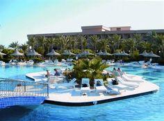 Egypte Hurghada Giftun Azur Hotel. Strandhotel, watersport Aan zandstrand. Restaurants en bars. Bungalows, tropische tuin, zwembad. Snorkelen. In nieuwe centrum met moderne boulevard,restaurants, winkels en terrasjes.