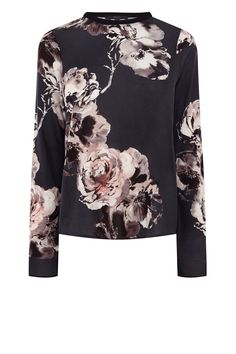 With a beautiful floral print and full length sleeves, the Akoni Printed Top is a versatile piece for your wardrobe. This lightweight top is designed to give effortless movement thanks to the loose cut. The zip on the shoulder adds a modern edge to an overall chic top. Wear this pop on top with skinny black trousers for a contemporary look this season.