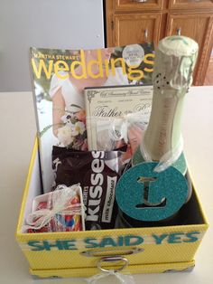 Engagement gift basket: chocolate, stuff with local bridal mags and brochures etc