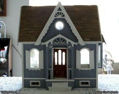 Ashley Cook photo - The front of Millie Combs dollhouse miniature called the Lafayette.