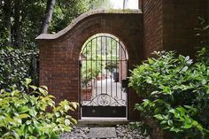 brick garden wall wrought iron fence arched doorway craftsman home Arch Gate, Arch Doorway, Entrance Gates, Front Gates, Front Fence, Front Porch, Brick Cottage, Tudor Cottage, Tudor House