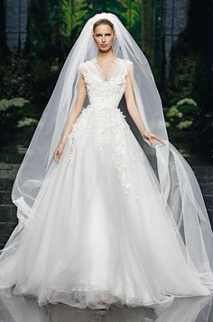 The Ball Gown is the wedding dress gold standard. It connotes formality and importance. Many brides choose a ball gown simply because it might be the only occasion when it's appropriate to wear such a dramatic dress. The term ball gown refers to the proper dress worn to a ball, and also to its full-