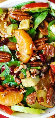 Apple Cranberry Spinach Salad Recipe. Ingredients include Pecans, Avocados (and Balsamic Vinaigrette Dressing) #glutenfree #vegetarian #salad
