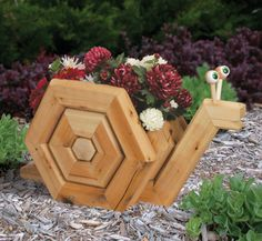 Rattle snake planter made from landscape timbers | Planter Project Plans - Landscape Timber Snail Planter Plan