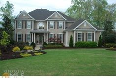 Traditional Exterior of Home with Glass panel door, Arched window, Pathway, Transom window