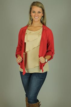 OPEN ARMS SHRUG...Such a great layering piece! The color is great, and the small studs on the shoulders are everywhere this season:) Throw this on over your favorite top for a casual look, or for an evening look, pair it over a dress!