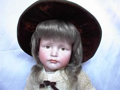 Hand-wefted mohair doll wig.