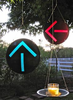 Trafficlight lens candle holder/birdfeeder and arrow