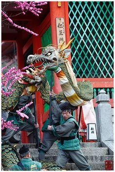 Dragon in front of temple gates during Seiryue festival in Kiyomizudera | Photograph by Damien Douxchamps