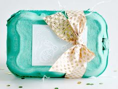The inside is filled with foil wrapped chocolate eggs in cupcake wrappers lined with shredded paper.