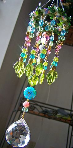☆ Welcome Spring Dangle Suncatcher » The longest dangle is a Gorgeous German Round Cut Crystal. In sunlight it casts Beautiful Rainbows in all directions. The piece is made entirely of Glass Beads with the exception of 3 beads - one each of Rose Quartz, Angelite, and Chrysoprase .:¦:. Etsy Shop: EarthStarStudios ☆
