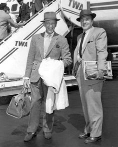Fred Astaire & Gene Kelly take a break from dance to fly to New York in 1958