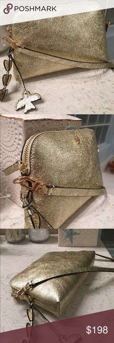 "Tory Burch Peace Metallic Gold Crossbody bag. Pretty crinkled soft leather in gold. Tassel on the side (removable) is in hearts and a bird....So cute. Removable strap takes it from cross body for day, to clutch for evening….. So versatile. Plenty of room inside for your phone, wallet, etc. New, never used, with Tag. Approximate measurements: 8.5"" L x 5.5"" H x 2"" D. Cross body strap 50 inches long total length. Tory Burch Bags Crossbody Bags"